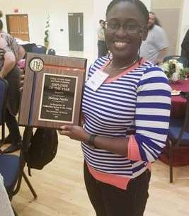 Melissa Naidu receives the 2018 Employee of the Year plaque