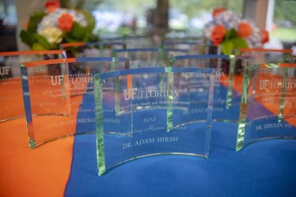 alumni awards sitting on table